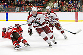 ?, David Valek (Harvard - 22), Alex Fallstrom (Harvard - 16) - The St. Lawrence University Saints defeated the Harvard University Crimson 3-2 on Friday, November 20, 2009, at the Bright Hockey Center in Cambridge, Massachusetts.