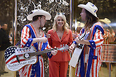 """Kellyanne Conway, campaign manager and strategist, is seen in the lobby of the Trump Tower with the """"Naked Cowboy"""" themed performers in New York, New York, on November 28, 2016.<br /> Credit: Anthony Behar / Pool via CNP"""