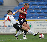 MAR 15, 2006: Faro, Portugal:  USWNT forward (20) Abby Wambach tries to keep the ball away from German midfielder (5) Britta Carlson in the finals of the Algarve Cup in Faro, Portugal.