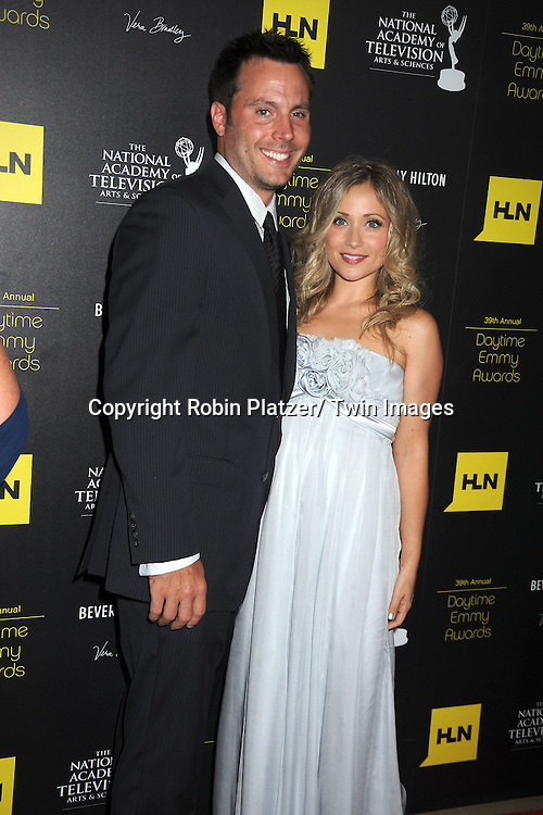 Don Money and Marci Rylan attends the 39th Annual Daytime Emmy Awards on June 23, 2012 at the Beverly Hilton in Beverly Hills, California. The awards were broadcast on HLN.