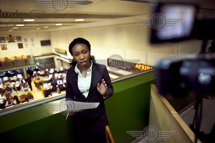 Nancy Illoh, a reporter on The Money Show, a program about finance and stocks on African Independent Television (AIT) broadcasts live from a balcony above the Nigerian Stock Exchange.