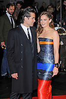 Colin Farrell and Ruth Wilson<br /> attending the 57th BFI London Film Festival Closing Night Gala World Premiere of 'Saving Mr Banks', Odeon Cinema, Leicester Square, London, England. <br /> 20th October 2013<br /> half length black orange blue grey gray  strapless stripe dress cuff bracelet coat suit profile <br /> CAP/MAR<br /> © Martin Harris/Capital Pictures