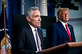 White House coronavirus adviser Dr. Scott Atlas speaks as United States President Donald J. Trump listens during a news conference in the James S. Brady Press Briefing Room at the White House, on Wednesday, September 16, 2020. <br /> Credit: Al Drago / Pool via CNP