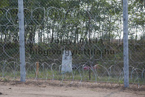 Some parts of the border fence between Hungary and Serbia are in their final form with a combination of a 3.5 m high fence with razor wire on it's top and bottom near Asotthalom (about 195 km South of capital city Budapest), Hungary on September 01, 2015. ATTILA VOLGYI
