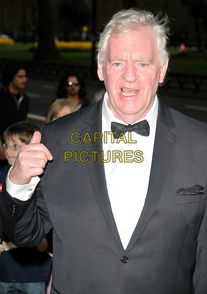 LAWRIE McMENEMY MBE.At the Professional Footballers' Association Awards, Grosvenor House hotel, Park Lane, London, England, UK, 25th April 2010..PFA half length black bow tie tuxedo tux hand mouth open .CAP/CAN.©Can Nguyen/Capital Pictures.