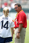 27 June 2004: League commissioner Tony DiCicco (right) and Nel Fettig (14). The San Diego Spirit defeated the Carolina Courage 2-1 at the Home Depot Center in Carson, CA in Womens United Soccer Association soccer game featuring guest players from other teams.
