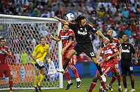 AC Milan defender Alessandro Nesta (13) sends a header on goal past Chicago Fire midfielder Justin Mapp (21) defends.  AC Milan defeated the Chicago Fire 1-0 at Toyota Park in Bridgeview, IL on May 30, 2010.