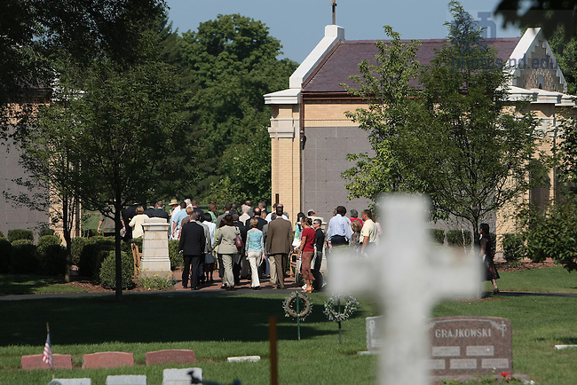 Guests gather at the new crypts for the dedication and blessing of Our Lady of Sorrows at Cedar Grove Cemetery.