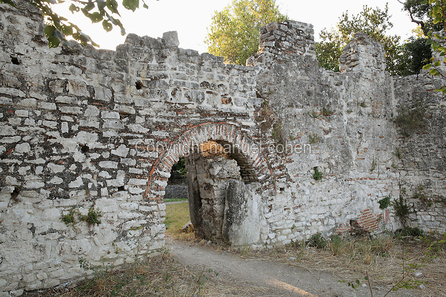 The Water Gate, 13th - 15th centuries, giving access to the South bank of the Vivari channel, Butrint, Chaonia, Albania. The gate has an arch of tile and stone, with a later buttress visible through the gateway. Butrint was founded by the Greek Chaonian tribe and was a port throughout Hellenistic and Roman times, when it was known as Buthrotum. It was ruled by the Byzantines and the Venetians and finally abandoned in the Middle Ages. The ruins at Butrint were listed as a UNESCO World Heritage Site in 1992. Picture by Manuel Cohen