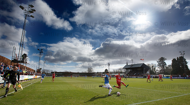 Snow then sunshine at Glebe park in the spring as Calum Gallagher crosses in from the wing.