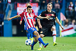 Angel Correa (l) of Atletico de Madrid battles for the ball with Julian Baumgartlinger of Bayer 04 Leverkusen during their 2016-17 UEFA Champions League Round of 16 second leg match between Atletico de Madrid and Bayer 04 Leverkusen at the Estadio Vicente Calderon on 15 March 2017 in Madrid, Spain. Photo by Diego Gonzalez Souto / Power Sport Images