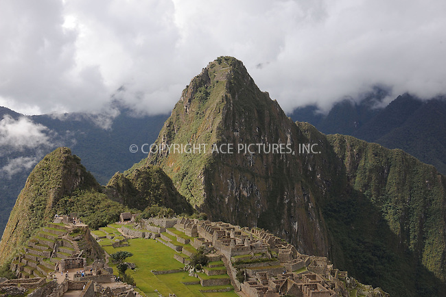 """WWW.ACEPIXS.COM . . . . . .January 8, 2013...Peru...Huayna Picchu also known as Wayna Picchu (Quechua: """"Young Peak"""") is a mountain in Peru around which the Urubamba River bends. It rises over Machu Picchu, the so-called lost city of the Incas, and divides it into sections. The Incas built a trail up the side of the Huayna Picchu and built temples and terraces on its top. The peak of Huayna Picchu is about 2,720 metres (8,920 ft) above sea level, or about 360 metres (1,180 ft) higher than Machu Picchu... January 8, 2013 in Peru ....Please byline: KRISTIN CALLAHAN - ACEPIXS.COM.. . . . . . ..Ace Pictures, Inc: ..tel: (212) 243 8787 or 212 489 0521..e-mail: kristincallahan@aol.com...web: http://www.acepixs.com ."""