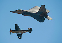 "121014-N-DR144-522 SAN DIEGO (October 14, 2012)- A United States Air Force F-22 Raptor joins a World War II vintage P-51 Mustang in a heritage flight during the Marine Corps Air Station Miramar 2012 Air Show. The air show, held October 12-14, was themed ""Marines In Flight: Celebrating 50 Years of Space Exploration."" (U.S. Navy photo by Mass Communication Specialist 1st Class James R. Evans / RELEASED)"