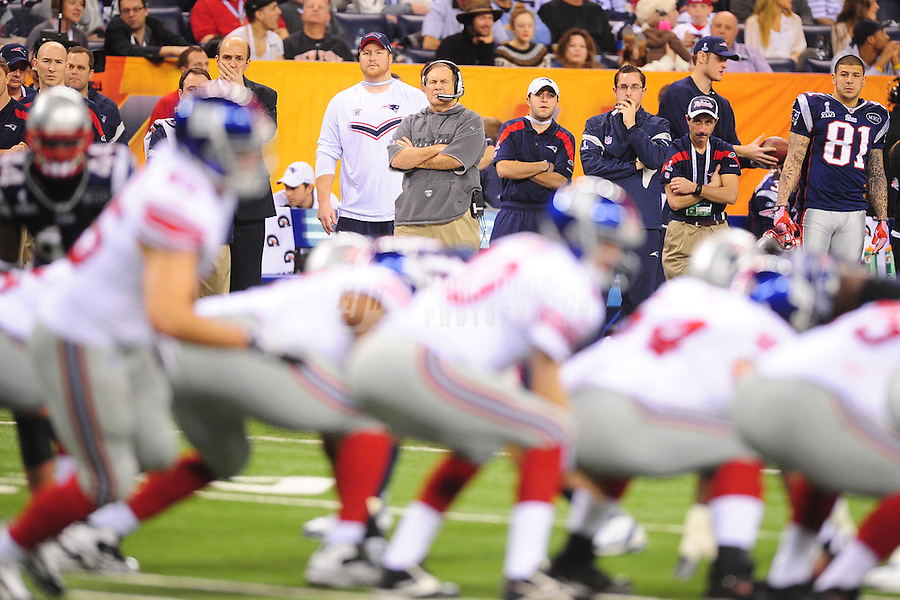 Feb 5, 2012; Indianapolis, IN, USA; New England Patriots head coach Bill Belichick watches from the sideline during the second half of Super Bowl XLVI against the New York Giants at Lucas Oil Stadium.  Mandatory Credit: Mark J. Rebilas-