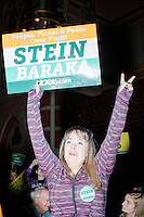 "Harvard grad student Megan Corry shows her support as Green Party presidential nominee Jill Stein speaks at a campaign rally at Old South Church in Boston, Massachusetts, on Sun., Oct. 30, 2016. Corry said she has been volunteering with the campaign. She was a lifelong Democrat and remembers attending campaign events for Michael Dukakis during his presidential bid. She worked for the Sanders campaign, but left the Democratic party at the DNC earlier in the year. ""I want to break up the two party system,"" she said."