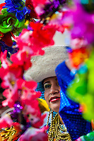 A woman dancer (danzante) takes part in the religious parade within the Corpus Christi festival in Pujilí, Ecuador, 1 June 2013. Every year in June, thousands of people gather in a small town of Pujili, high in the Andes, to celebrate the Catholic feast of Corpus Christi. Introduced originally during the Spanish conquest of South America, this celebration merges Catholic rituals of Holy Communion with the traditional Andean harvest and sun festivities (Inti, the Inca sun god). Women dancers perform wearing brightly colored costumes while men dancers wear chest ornaments and heavy elaborate headdresses adorned with mirrors, jewelry, or natural items (shells). Being a dancer in the Corpus Christi ceremonial parade (El Danzante) is considered an honour and a privilege by the indigenous people in Ecuador.