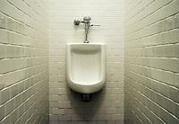 Urinal in men's restroom.