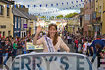 Kerry Rose Karen McGillicuddy leads the Coronation parade through her hometown on Monday