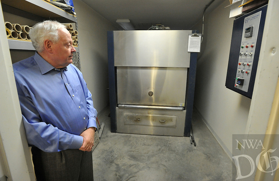NWA Democrat-Gazette/MICHAEL WOODS &bull; @NWAMICHAELW<br /> Tommy Holland, with Beard's Funeral Chapel in Fayetteville, shows the crematorium at the Fayetteville Funeral Chapel Tuesday November 3, 2015.
