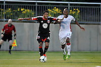 Lionard Pajoy (26) of D.C. United goes against Jose Concalves (23) of the New England revolution. D.C. United defeated the The New England Revolution 3-1 in the Quarterfinals of Lamar Hunt U.S. Open Cup, at the Maryland SoccerPlex, Tuesday June 26 , 2013.