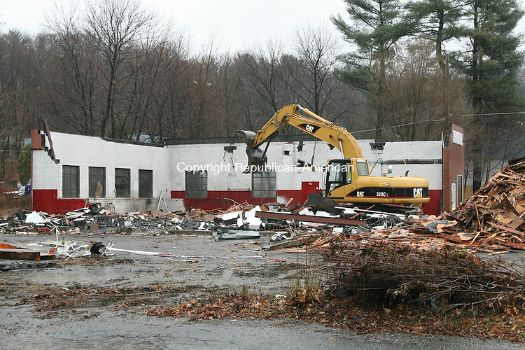TORRINGTON, CT - 10 December, 2008 - 121008MO03 - Crews from Waterbury Wrecking tear down the former home of Ron's Automotive Center on Winsted Road Wednesday to make way for Center Subaru, which plans to re-locate from its current home at 516 Winsted Road. Ron's Automotive has operated on Scoville Street for a little over two years. Jim Moore Republican-American.