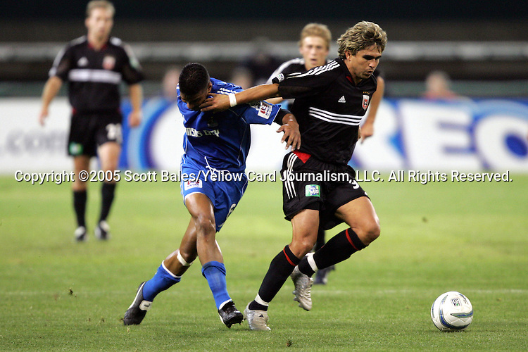 21 May 2005: DC United's Jaime Moreno (right) holds off Kansas City's Jose Burciaga Jr. in second half action. DC United defeated the Kansas City Wizards 3-2 at RFK Stadium in Washington, DC in a regular season Major League Soccer game. . .