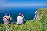 Bird watching along the cliffs of St. Paul, Pribilof Islands, Bering Sea, Alaska.