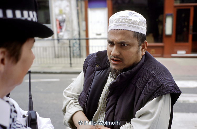 Community Sector Officer from the Brick Lane Police Office in Spitalfields, East London, talks to a local resident.