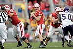 MADISON, WI - SEPTEMBER 9: Offensive lineman Andy Kemp #75 and Marcus Coleman #65 of the Wisconsin Badgers pass block as quarterback John Stocco drops back to pass against the Western Illinois Leathernecks at Camp Randall Stadium on September 9, 2006 in Madison, Wisconsin. The Badgers beat the Leathernecks 34-10. (Photo by David Stluka)