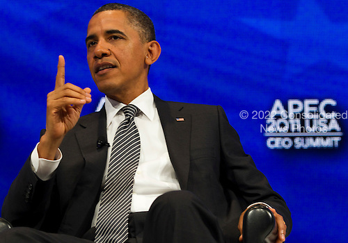 United States President Barack Obama answers questions at the Asia-Pacific Economic Cooperation (APEC) CEO Summit at the Sheraton Waikiki Hotel  in Honolulu, Hawaii on Saturday, November 12, 2011..Credit: Kent Nishimura / Pool via CNP