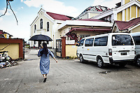 The Cathedral of Our Lord's Transfiguration Parish was about the celebrate its 75 years anniversary and was completly renovated before the typhoon hit it and destroyed the roof. Sister Gertrude passing by to check the casualities the day before the anniversary. <br /> <br /> La cath&eacute;drale &quot;Our Lord's Transfiguration Parish&quot; devait f&ecirc;ter ses 75 ans et a &eacute;t&eacute; enti&egrave;rement r&eacute;nov&eacute; avant que le typhon la frappe et d&eacute;truise le toit. Soeur Gertrude en passant par  l&agrave;, v&eacute;rifie les d&eacute;g&acirc;t la veille de l'anniversaire.