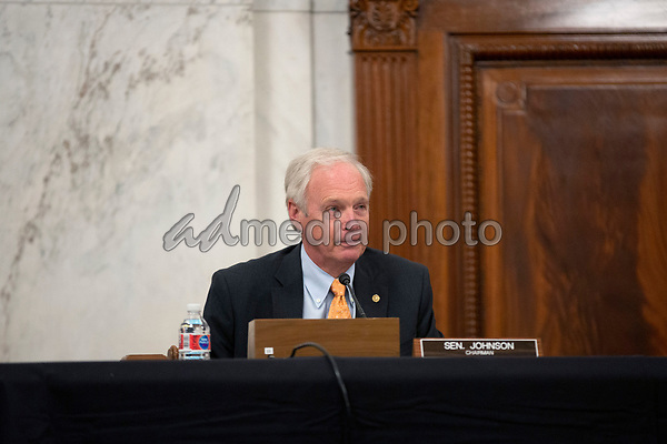 United States Senator Ron Johnson (Republican of Wisconsin) listens during a U.S. Senate Committee on Homeland Security and Governmental Affairs meeting in the Senate Russell Office Building in Washington D.C., U.S., on Wednesday, May 20, 2020, to consider a motion to issue a subpoena to Blue Star Strategies.  Credit: Stefani Reynolds / CNP/AdMedia