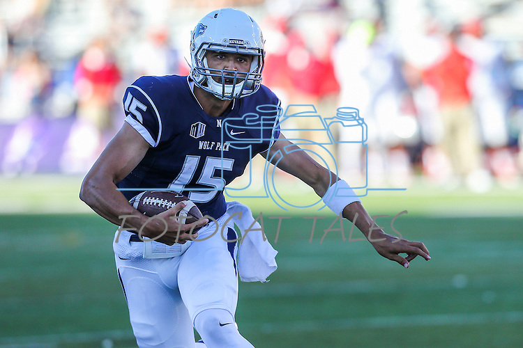 Nevada quarterback Tyler Stewart scores against New Mexico during the first half of an NCAA college football game in Reno, Nev., on Saturday, Oct. 10, 2015. Nevada won 35-17. (AP Photo/Cathleen Allison)