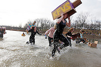 Participants take the plunge into 46-degree water during the sixth annual Polar Plunge to raise money for Special Olympics Missouri on Saturday, Feb. 4, 2012, at Lake Boutin in Trail of Tears State Park.