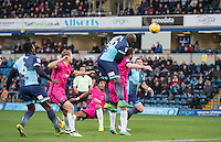 Adebayo Akinfenwa of Wycombe Wanderers heads a shot at goal  during the Sky Bet League 2 match between Wycombe Wanderers and Hartlepool United at Adams Park, High Wycombe, England on 26 November 2016. Photo by Andy Rowland.
