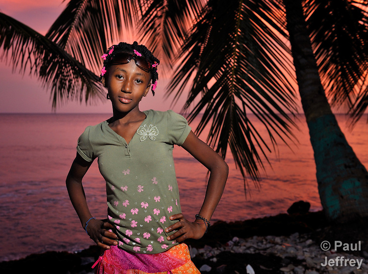 "Romage Jean Louis, a member of Nouvel Etwal - Haitian Kreyol for ""New Stars"" - poses on the beach at Jacmel, Haiti. Nouvel Etwal is a dance and creative movement group of 16 girls from age 8 to 13, based in the southern village of Mizak. According to Valerie Mossman-Celestin, an organizer of the group, ""Nouvel Etwal seeks to empowers girls to be self-confident and creative. The girls learn flexibility, discipline and teamwork, lessons they also need for life. Nouvel Etwal promotes health, well-being and enhanced self-worth. The girls are encouraged to live into a brighter future where girls and women are valued,  educated, and have equal opportunity to achieve their potential."""