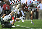 Oregon's Jeff Maehl upends Ohio State's Anderson Russell during a kick off return in the 96th Rose Bowl in Pasadena, Ca January 1, 2010.