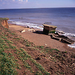 A294R5 Second world war pillbox eroded by the sea Bawdsey Suffolk England