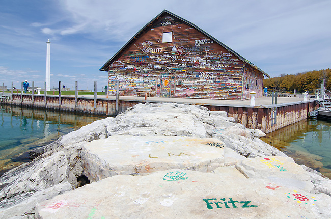 Anderson Dock is an old barn/dock warehouse owned by the Village of Ephraim and houses a public art gallery (The Hardy) and restrooms, Ephtraim, Door County, Wisconsin, Respectful graffitti is encuraged from boaters who dock at the pier,