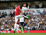 Tottenham's Dele Alli tussles with Manchester United's Phil Jones during the Premier League match at White Hart Lane Stadium, London. Picture date: May 14th, 2017. Pic credit should read: David Klein/Sportimage
