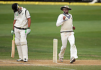 India's Harbahjan Singh (right) does a comical walk as he changes fielding position as James Franklin waits at the crease during day four of the 3rd test between the New Zealand Black Caps and India at Allied Prime Basin Reserve, Wellington, New Zealand on Monday, 6 April 2009. Photo: Dave Lintott / lintottphoto.co.nz.