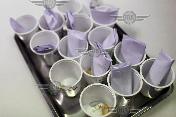 Medication in named cups on a tray at the Occidental treatment centre for drug addiction in Porto. In 2000, the government passed a law that changed possession of drugs from a judicial issue to a matter of public and community health. According to the Institute for Drugs and Drug Addiction, a branch of Portugal's Ministry of Health, the number of heroin users has dropped from 100,000 in 2000, to 55,000 users in 2008.