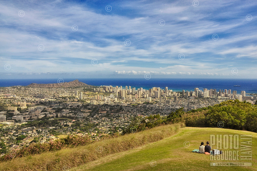 A couple enjoys a picnic and the view of Honolulu at Pu'u 'Ualaka'a State Park, O'ahu.