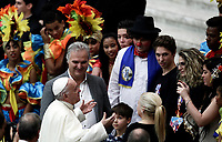 Papa Francesco saluta gli artisti del Circo Cubano al termine dell'Udienza Generale del mercoledi' in aula Paolo VI in Vaticano, 20 dicembre 2017.<br /> Pope Francis greets artist from the Cuban Circus at the end of his weekly general audience in Paul VI Hall at the Vatican, on December 20, 2017.<br /> UPDATE IMAGES PRESS/Isabella Bonotto<br /> <br /> STRICTLY ONLY FOR EDITORIAL USE