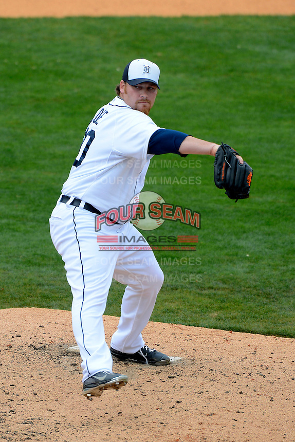 Detroit Tigers pitcher Phil Coke #40 during a Spring Training game against the New York Mets at Joker Marchant Stadium on March 11, 2013 in Lakeland, Florida.  New York defeated Detroit 11-0.  (Mike Janes/Four Seam Images)
