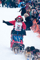 Bob Hickel team leaves the start line during the restart day of Iditarod 2009 in Willow, Alaska