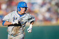 UCLA CF Beau Amaral rounds third in Game Two of the NCAA Division One Men's College World Series Finals on June 29th, 2010 at Johnny Rosenblatt Stadium in Omaha, Nebraska.  (Photo by Andrew Woolley / Four Seam Images)