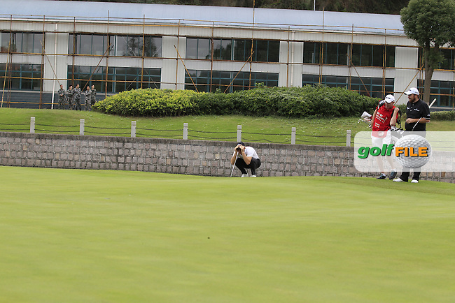 Thomas Pieters (BEL) and, Shane Lowry (IRL) on the 4th green watched by members of the Chinese army during the final round of the WGC-HSBC Champions, Sheshan International GC, Shanghai, China PR.  30/10/2016<br /> Picture: Golffile | Fran Caffrey<br /> <br /> <br /> All photo usage must carry mandatory copyright credit (&copy; Golffile | Fran Caffrey)