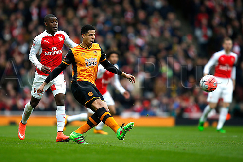 20.02.2016. The Emirates, London, England. Emirates FA Cup 5th Round. Arsenal versus Hull City. Curtis Davies of Hull plays a pass under pressure from Joel Campbell of Arsenal