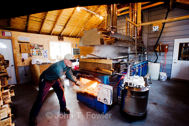 Stoking wood fired furnace of maple syrup evaporator system